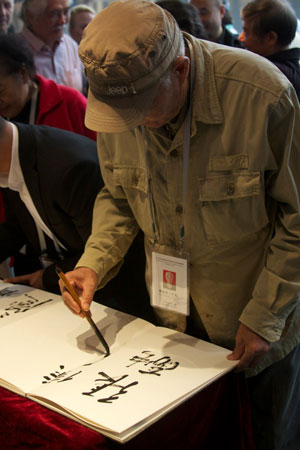 Signing guest book in China